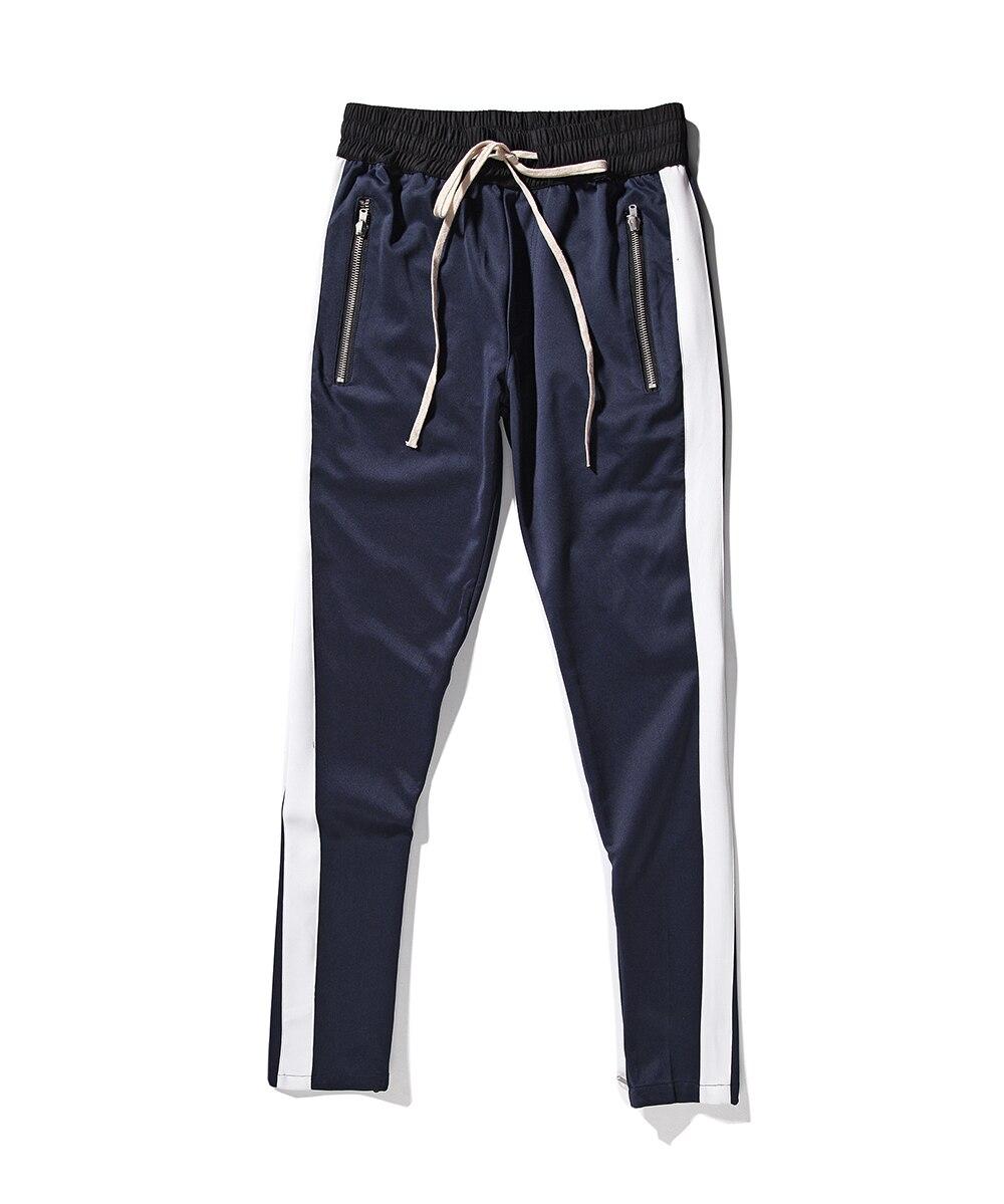 2017 Nuovi fondi cerniera laterale pantaloni hip hop Moda urbana vestiti  justin bieber NEBBIA Che Unisce insieme pantaloni jogger Nero rosso blu in  2017 ... 21a9176f2a57