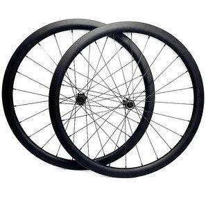 Image 1 - 700c strada ruote a disco 50x27 millimetri tubeless Freno A Disco della bici della strada ruote NOVATEC 100x12mm 142x 12mm Center lock strada ruota a disco in carbonio