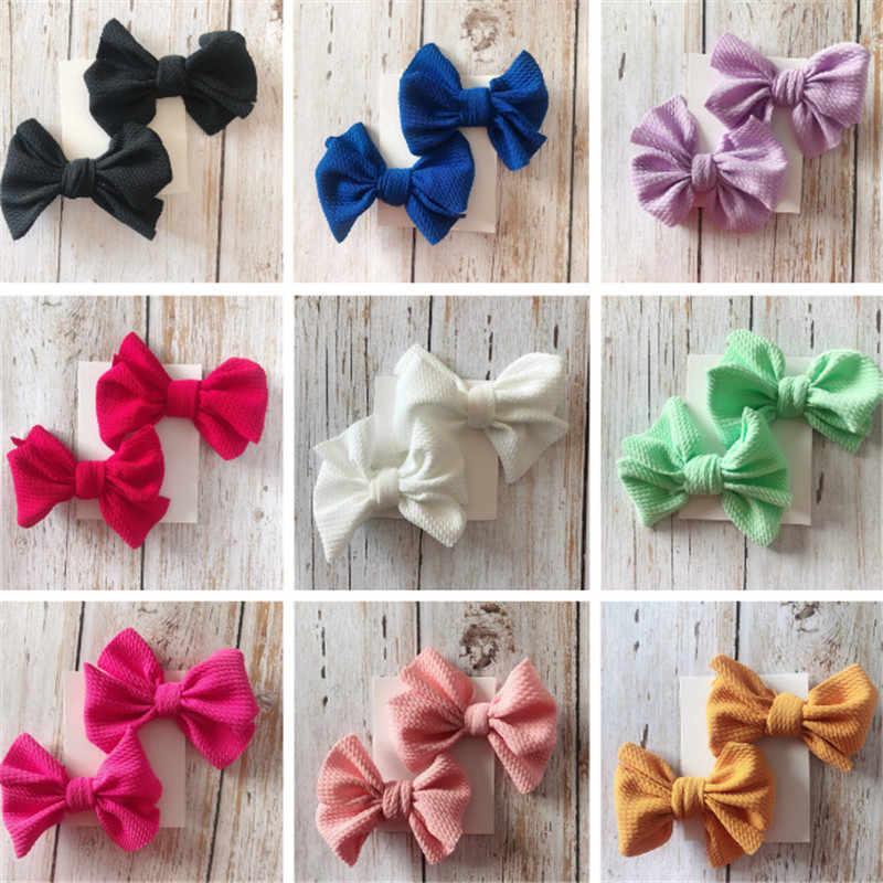 Solid 9 kleuren Fashion Babe hoofddeksels Accessoires 1 paar Pasgeboren baby Meisje Leuke Stretch hoofdbanden haarspelden Strik clip hoofdtooi