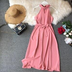 Image 1 - FMFSSOM Women Sexy Hanging Neck Dress 2020 New Summer Ladys O Neck Sleeveless With Belt Medium Long Slim Dresses