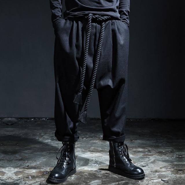 Hombres Bolsillos Loose Cordón Ocho Puntos Harem Pantalón Negro Marca de Moda Pantalones de Pierna Ancha Ocasional 2016 Nuevo