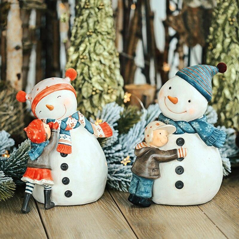 Accessoires de décoration pour la maison un petit garçon et une petite fille tenant un bonhomme de neige décoration Figurine salon ornement cadeau