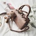 Free shipping, 2017 new woman fashion handbags, trend leisure messenger bag, simple Korean version women bag, bear ornament flap