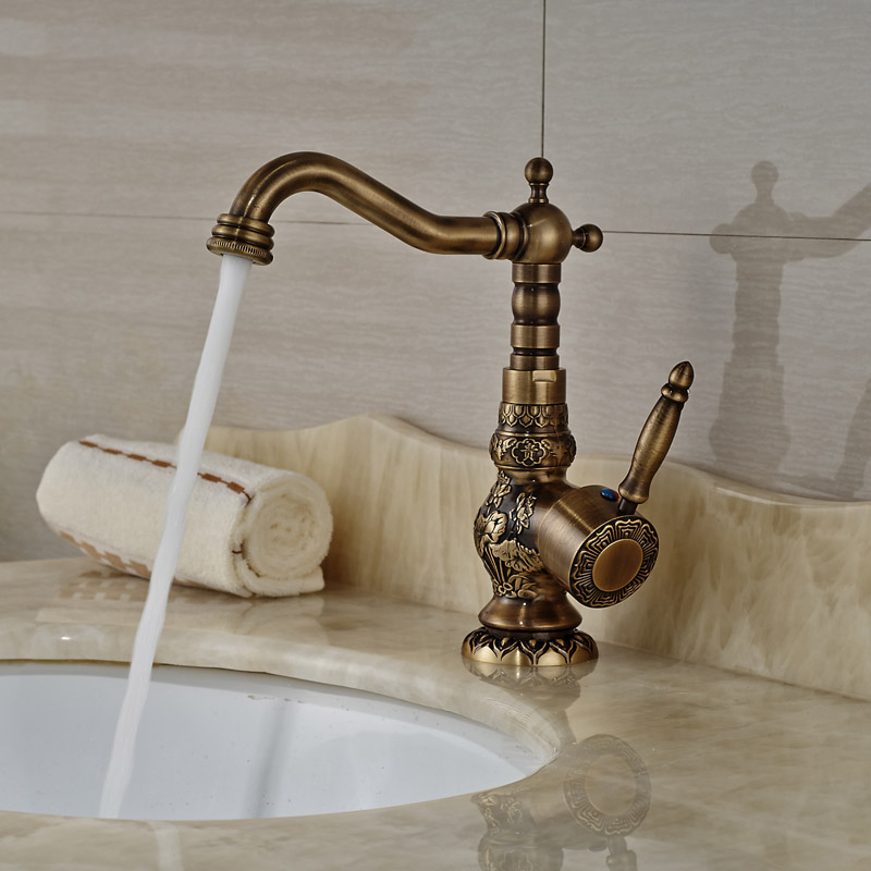 Artistic Carved Face Brass Basin Sink Faucet Deck Mount Antique Single Handle Hot Cold Mixer Taps for Bathroom deck mount creative design basin sink faucet single handle chrome hot cold water vanity sink mixer taps