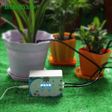 hot deal buy 1 set intelligent home automatic watering device garden plant drip irrigation tool water pump timer controller 11pcs arrow kits