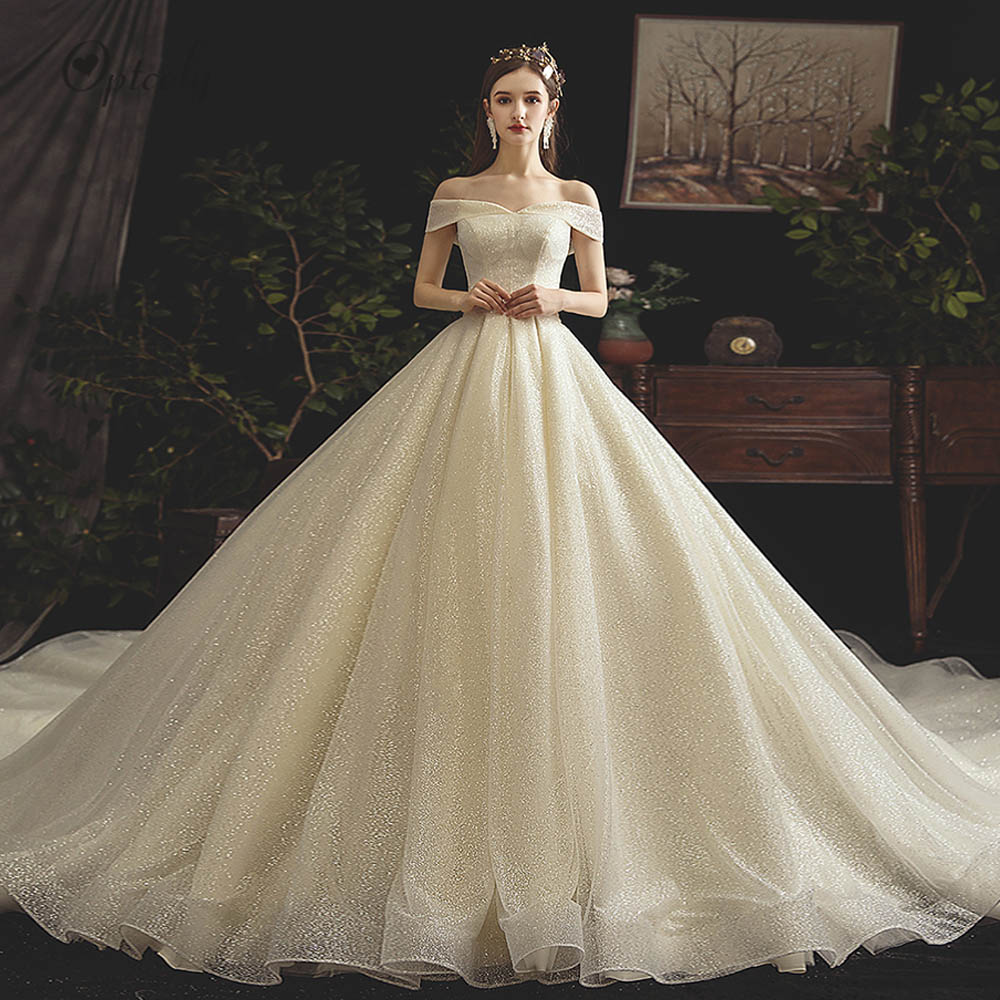 Optcely nouveauté Pure couleur bateau cou sans manches a-ligne robe de mariée 2019 élégant luxe chapelle Train robes de mariée Vintage