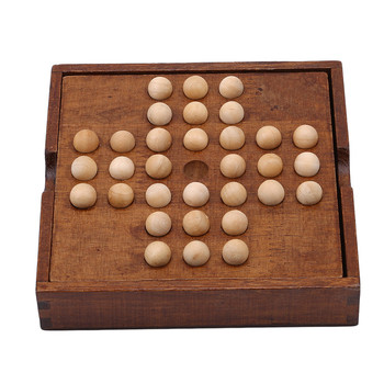 this image shows the wooden solitaire board game setup ready to play
