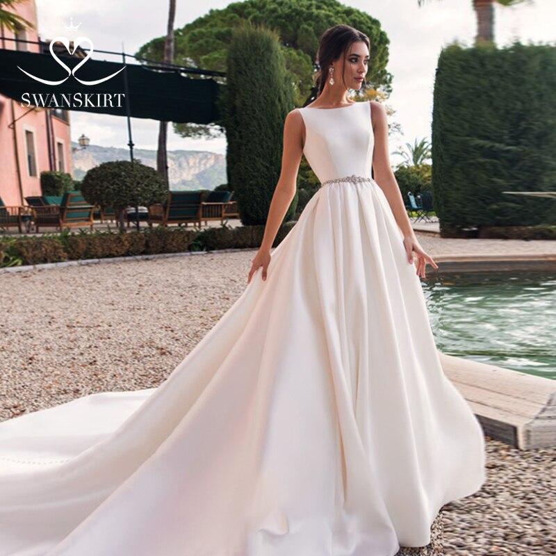 Image 2 - Swanskirt Luxury Satin Wedding Dress 2019 New Crystal Belt Backless A Line Princess Court Train Bride Gown Vestido de Noiva K167-in Wedding Dresses from Weddings & Events