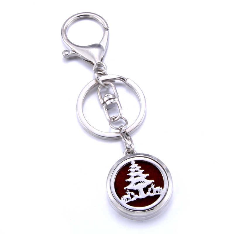 Christmas tree Aromatherapy Locket พวงกุญแจ aroma diffuser รถ keychain Essential Oil Diffuser พวงกุญแจจี้ของขวัญ