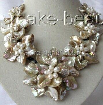 Lhx5568 >> >> clásico blanco barroco de la perla de la flor de shell de cuero necklac