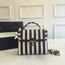 In 2016 the new black and white red and white striped Bag Leather Flip single shoulder bag handbag
