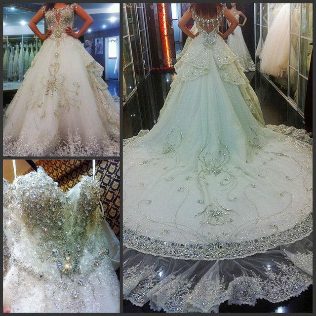 Extravagant Rhinestones Beaded Deep V Bodice Sequins Lace Hemline Royal Train Ball Gown Bridal