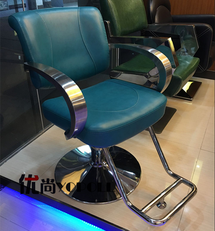 The new European hair salons dedicated hairdressing chair. Haircut chair. The barber's chair. The chair down the beauty chair swivels the chair the hairdresser slides the chair