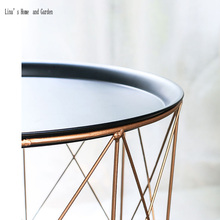 modern rose golden round wire metal storage basket side table