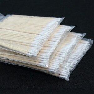 Image 1 - Cotonete de madeira para maquiagem permanente, ponta para cotonete, algodão, madeira, maquiagem permanente, jóias médicas de 7cm, varas limpadas com 100 peças