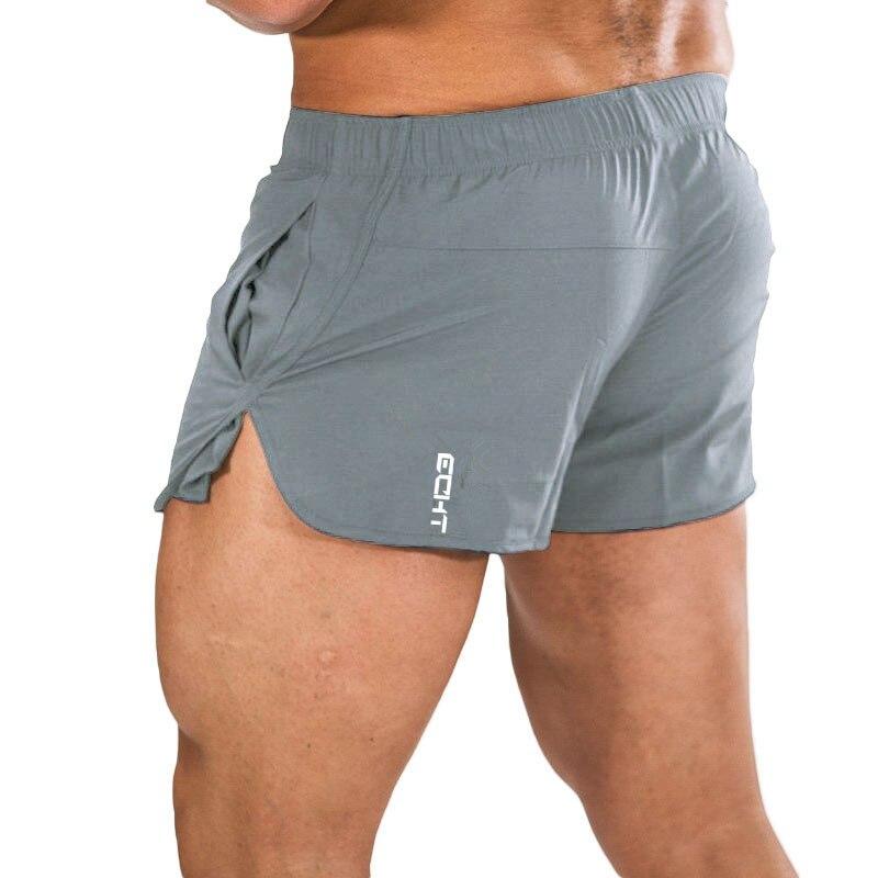 YEMEKE Mens Gym Fitness Shorts Run Jogging Sports Loose Cool Mesh Quick Dry Bodybuilding Sportswear Male Short Pants