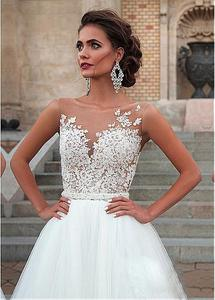 Image 2 - Charming Tulle Wedding Gowns Sleeveless O Neck A Line Dresses with Appliques Sexy Illusion Design Bridal Gowns Cheap