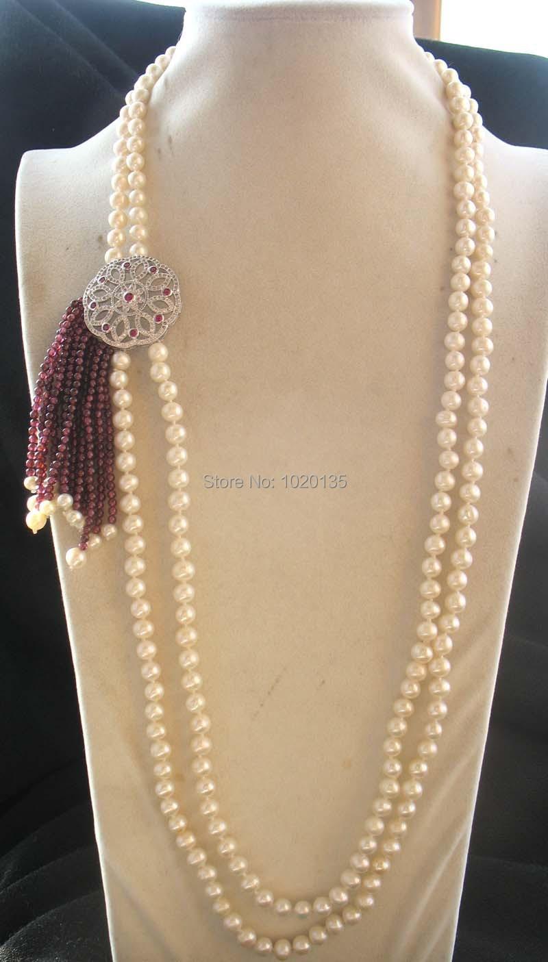 Collier 2 rangs perles deau douce blanc AA 6-7mm rond $ grenat 28-30 nature FPPJCollier 2 rangs perles deau douce blanc AA 6-7mm rond $ grenat 28-30 nature FPPJ