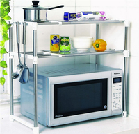 Microwave oven rack oven shelf shelf stainless steel clad pipe in the kitchen Can control the tensile Move up and down double