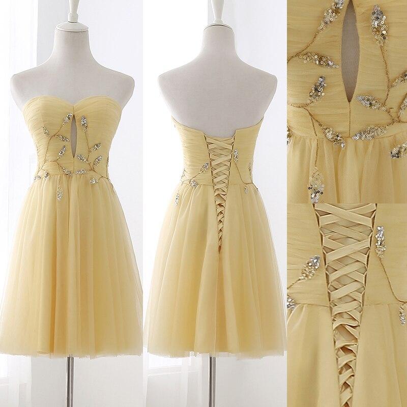Juguetona sexy vestidos de cóctel con un line backless sin tirantes sin mangas c