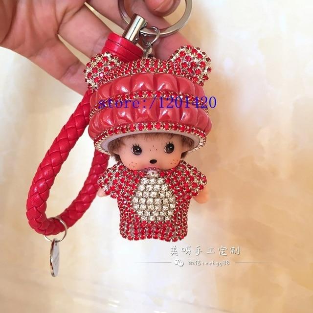 Monchichi lindo gatito rojo de cristal llaveros de cuero hebilla para teclas Monchhichi llavero cabeza de oso encanto del bolso del bolso bug