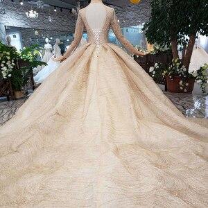 Image 2 - HTL245 Lange mouwen trouwjurken champagne hoge hals kralen bridal jurken baljurk keyhole terug jurk 2019 promotie