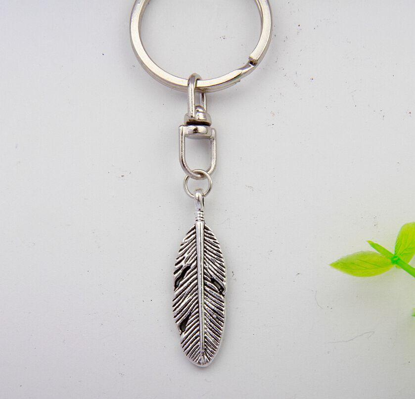 ecdaa7db5d Nueva joyería de moda plata de la vendimia alas del ángel hojas encanto  llavero anillo Llaveros Accesorios regalos de vacaciones mujeres 50 unids  d260