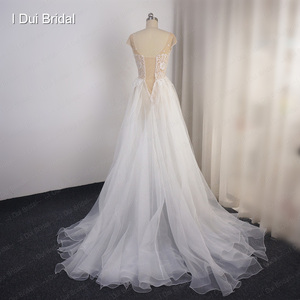 Image 4 - Cap Sleeve Sparkle Wedding Dress with Organza Ruffles Illusion Neckline Shinny Bridal Gown