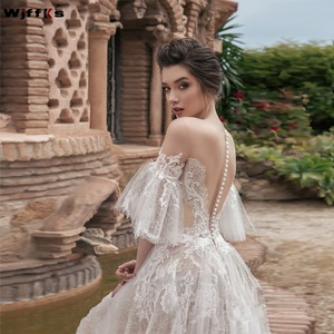 Image 1 - WJFFKS 2019 nouveau bijou cou pure demi manches longues a ligne robes de mariée Illusion retour avec boutons longues robes de mariée