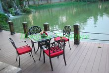 Outdoor cast aluminum four chair one table furniture set with cushions
