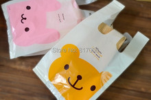 free shipping 20pcs/lot 15*28cm cute bear and rabbit vest handles cookie packaging plastic bags(China (Mainland))