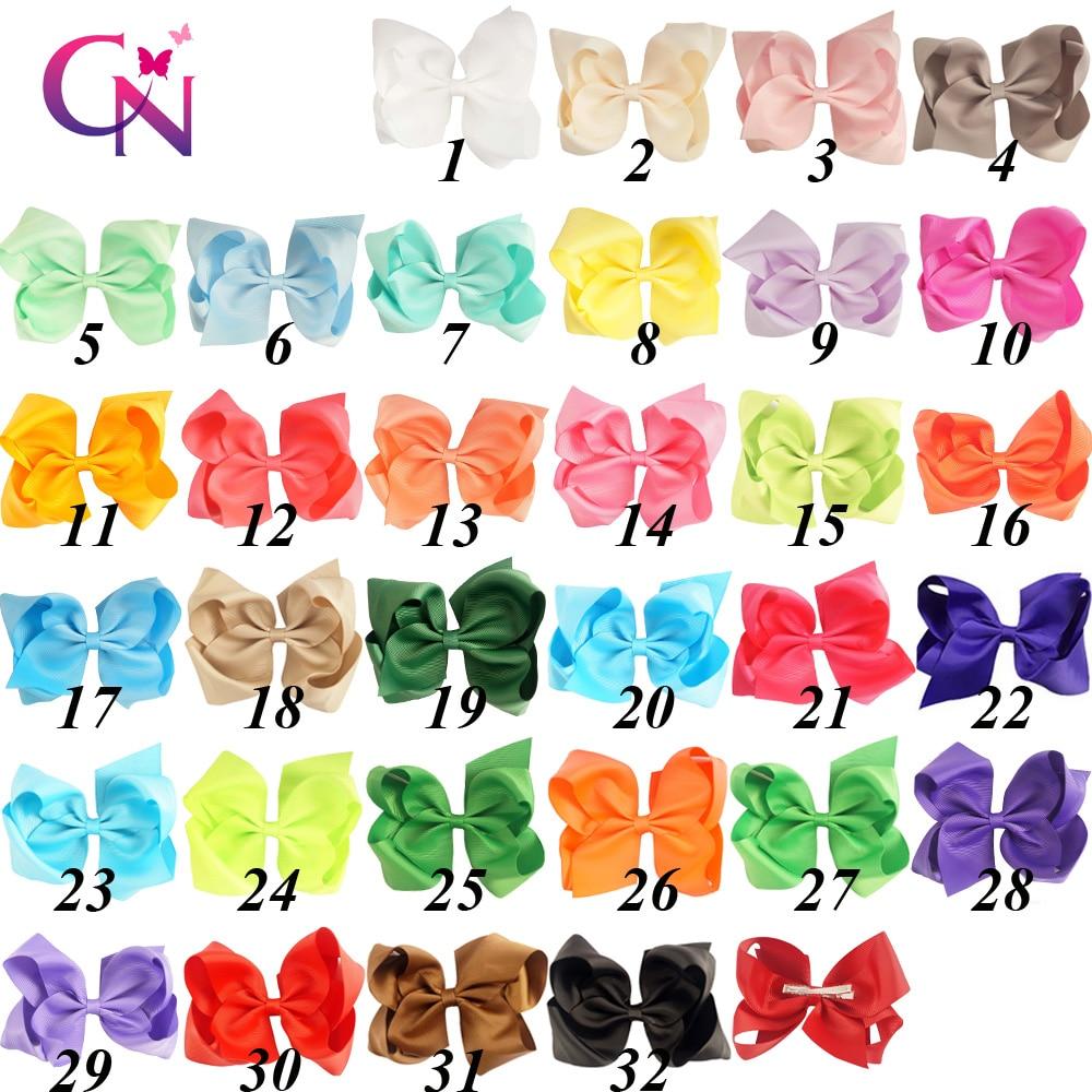 32 Hair Bows Omani