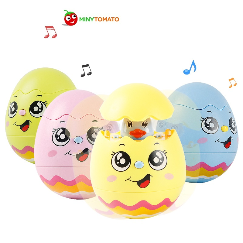 Free Shipping 4 color Baby Toy Music Egg Tumbler Doll with music and light Musical Rattles Toys For Babies Newborns Roly-poly