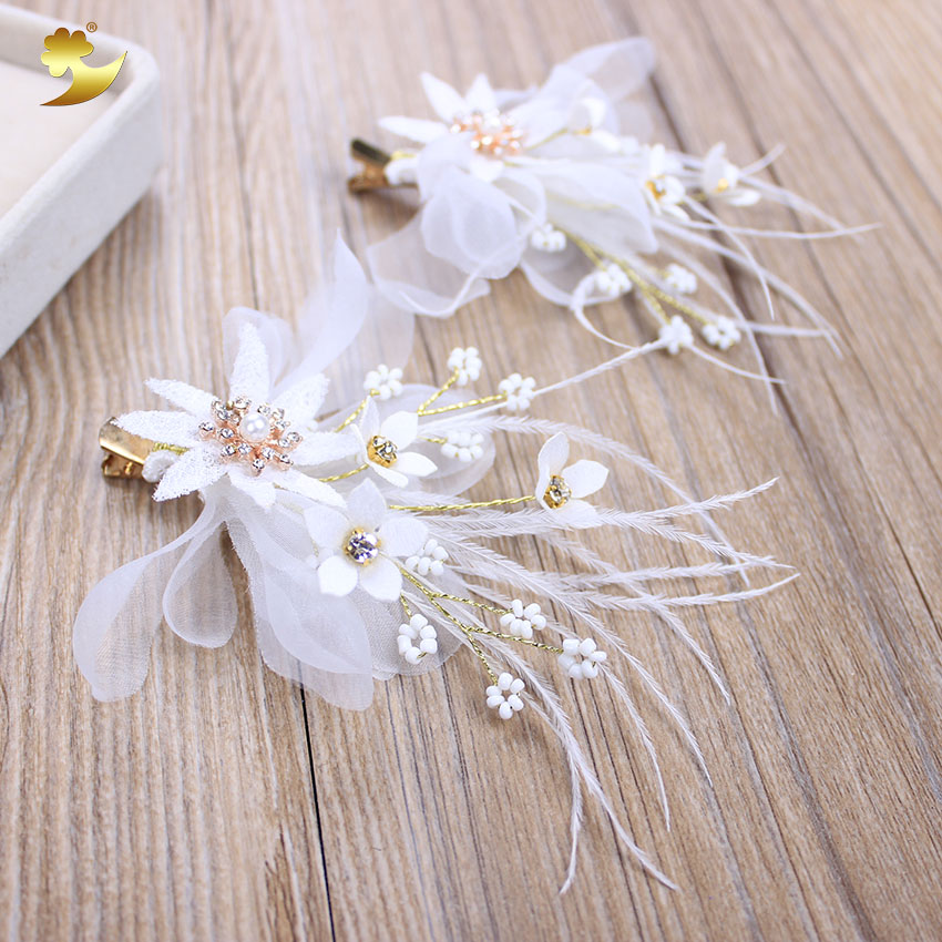 Xinyun new white flower hair clip feather hair decoration flower xinyun new white flower hair clip feather hair decoration flower hairclip girls crystal hair accessories for women hair barrette in hair accessories from mightylinksfo
