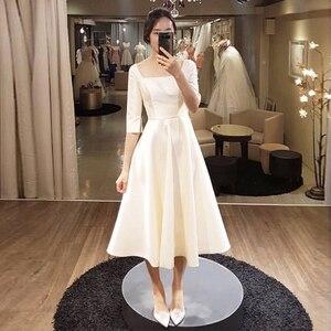 Image 1 - Simple Tea Length Wedding Dresses With Half Sleeves White Ivory Korea Bridal Dress Vestido De Novia Cheap A line Wedding Gowns