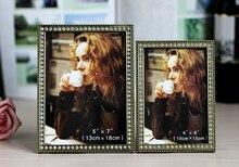 купить Metal photo frame inlaid brick  table creative European wedding photo frame small luxury ornaments simple photo frame по цене 1190.61 рублей
