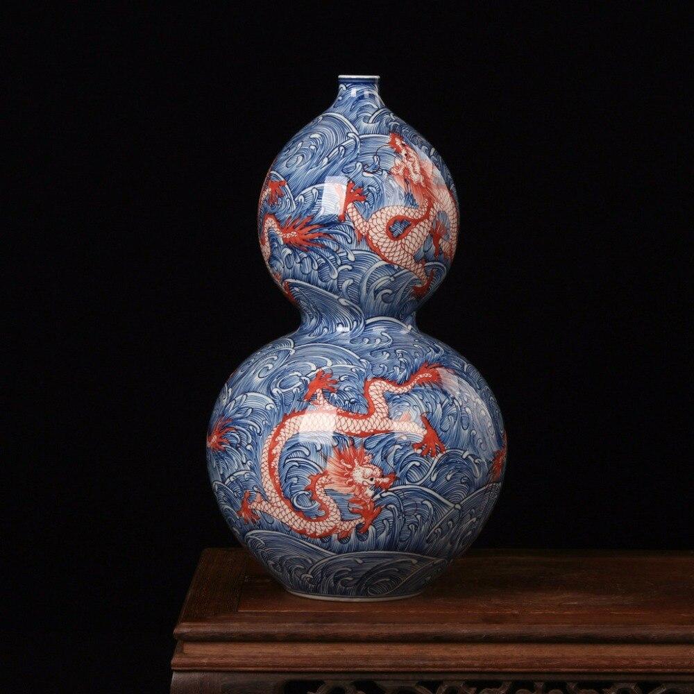 Unique porcelaine chinoise Antique bleu et blanc peint à la main sous émail dragon rouge en mer motif décoratif Vase à fleurs