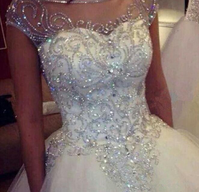 Dazzling Princess Sparkly Wedding Dresses 2019 Jewel Neck Cathedral Train Cap Sleeve Handmade Rhinestones Crystal Wedding Gown