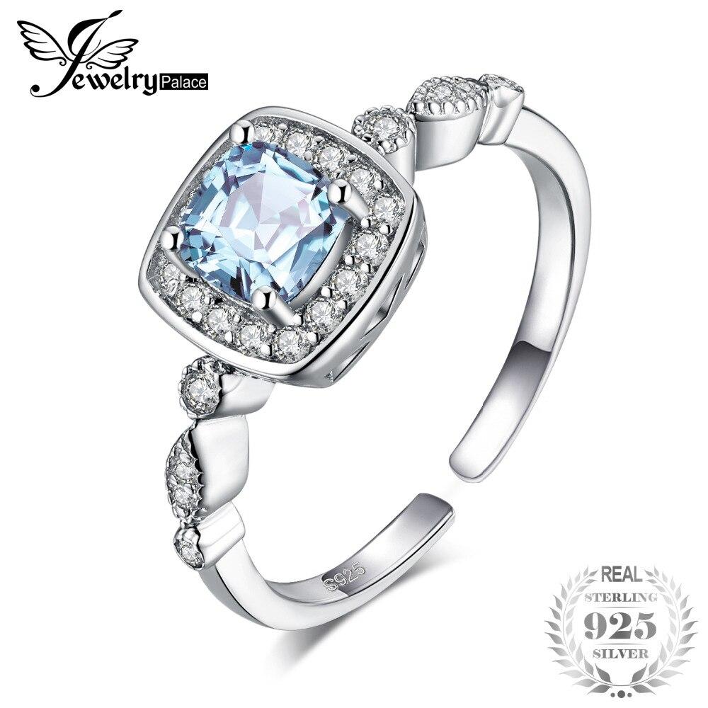 d71444e443b8 JewelryPalace 0.9ct corte Topacio Azul genuino Marquesa Zirconia cúbico  Halo ajustable Anillos de Compromiso de Plata de Ley 925
