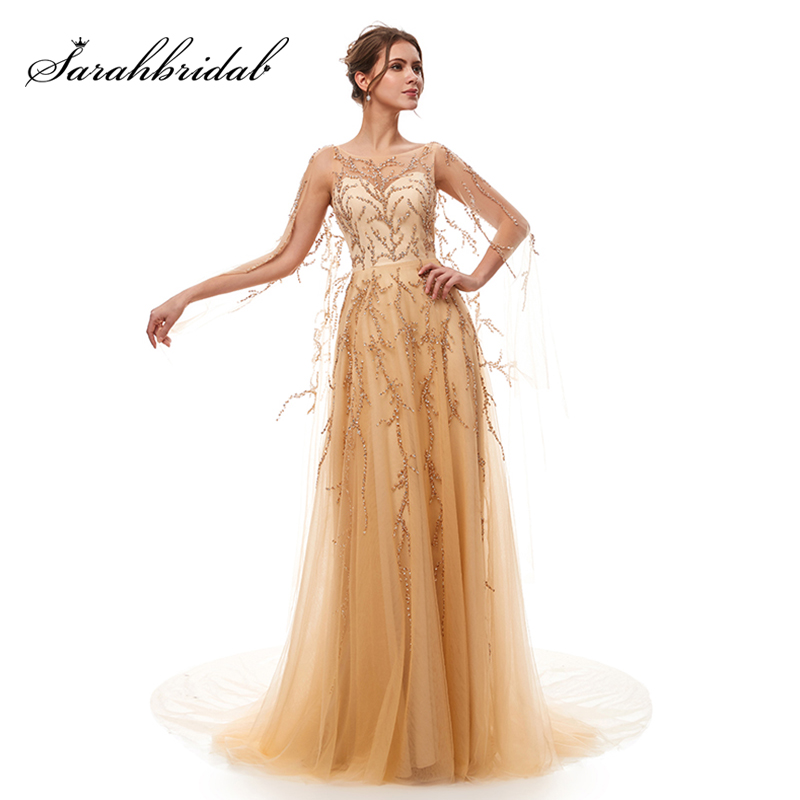 2019 New Gorgeous Beading Celebrity Dresses Long Champagne Tulle A Line Sexy Backless Evening Gown in