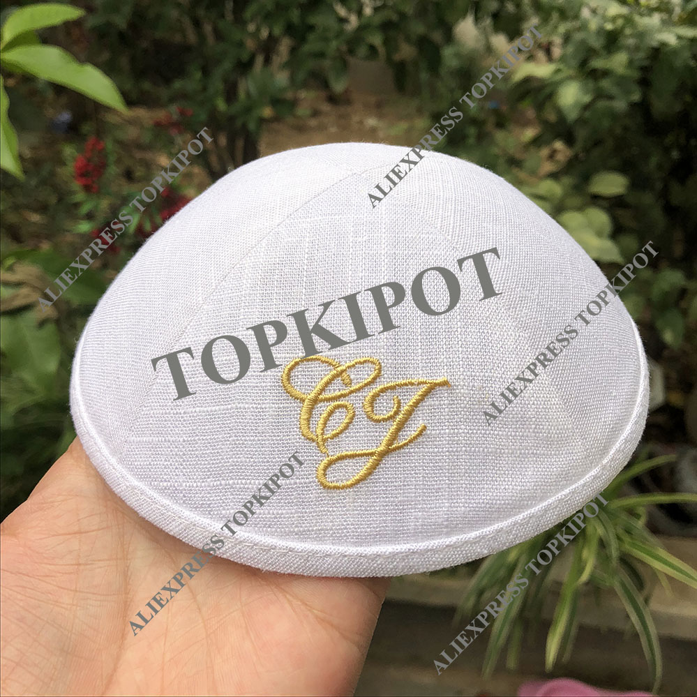 white linen kippah caps with gold embroidery logo