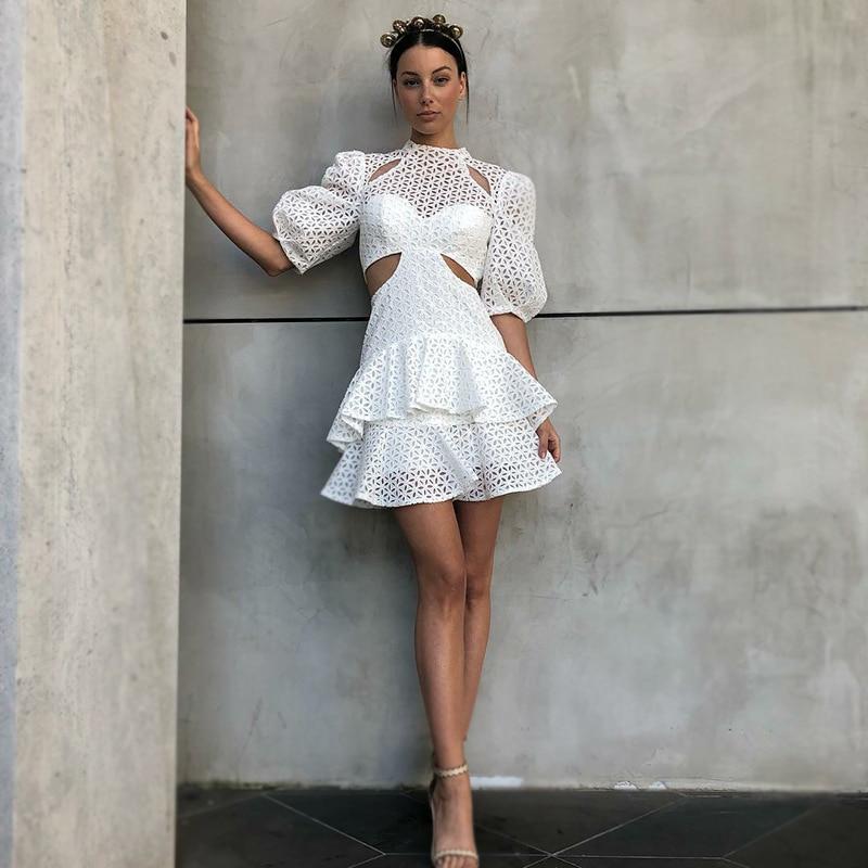 2019 été nouvelles femmes robe couleur unie creux taille haute manches bouffantes à volants petite robe robe de mode blanche