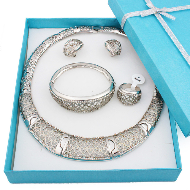 Alta calidad vintage plateado ahueca hacia fuera el corazón pendientes del collar y del brazalete de la moda mujeres set de joyas