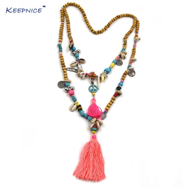 a51256aa5b75 Nuevos accesorios de vestir Bohemia étnica madera cuentas borla collar  largo colorido flecos largos paz Colgantes