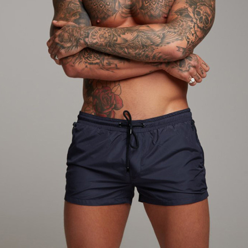 2019 New Swimwear Men Sexy Swimsuit Mens Swimming Shorts Men Briefs Beach Shorts Sports Suits Surf Board Shorts Men Swim Trunks in Body Suits from Sports Entertainment
