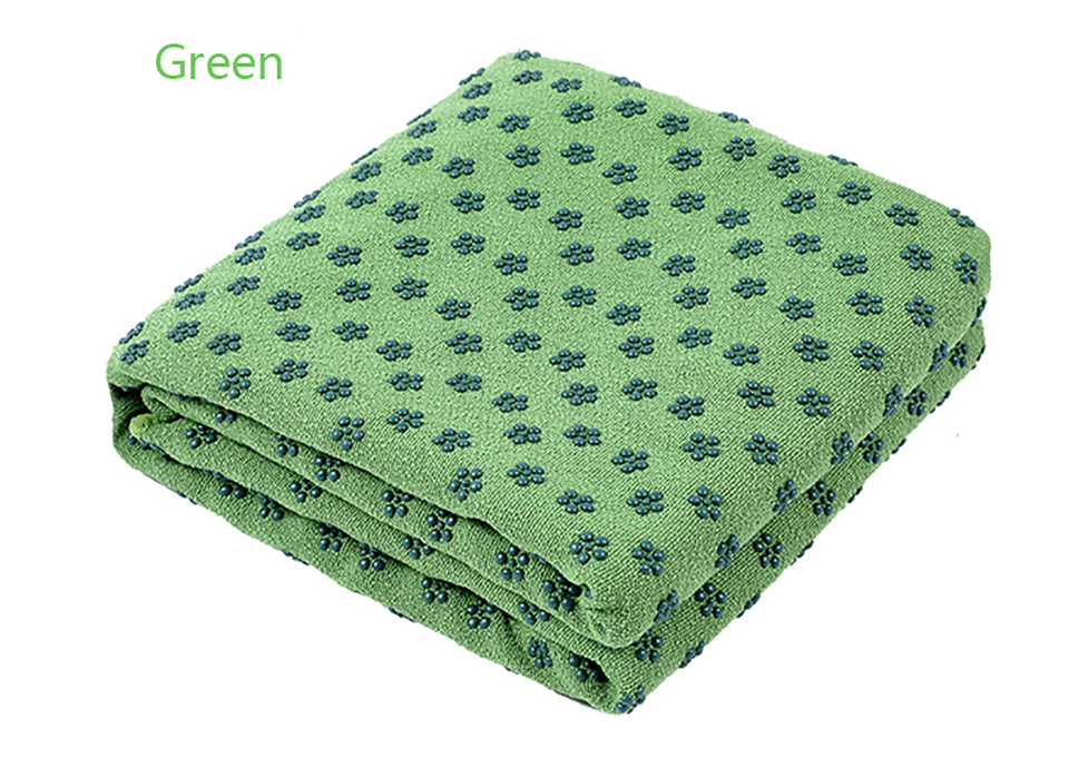 Photo of green color Yoga mat towel of microfiber & bag. Workout ultrafiber towel mat & mesh bag