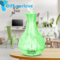 Diffuserlove 550ML Aroma Essential Oil Diffuser Ultrasonic Air Humidifier with Wood Grain 7 Color Changing LED Light for Home