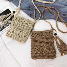 Womens hollow woven shoulder slung fringed straw bag