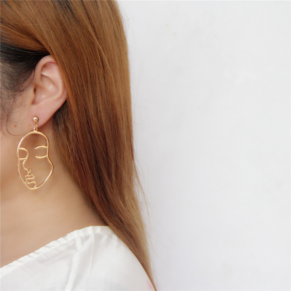 European and American new texture aesthetically interesting and funny side abstract face shape double-sided earrings ...