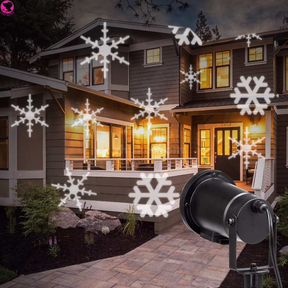 ФОТО Magical Outdoor and Indoor Christmas Laser Light, Gives Off Brilliant Lights with Snowflake Rotate and Move Electricity EVENT